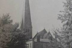 This century-old view of Holy Trinity shows the manor house next door. Today this site is occupied by Trinity Trading Estate.