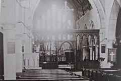 Entering the church, this view shows the original rood screen and cross, which were removed in 1922.