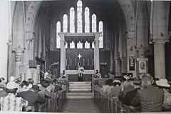 The final blessing, sometime in the 1950s. Note the curtain across the east wall, concealing the carved reredos and murals.
