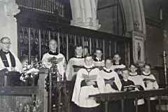 Note the organ in its original location in the vestry.Back row - Fr R W Stephenson, Fred Cooper, Colin ?, Steve James and ?.Front row - ? Budd, Michael Rowlands, Geoffrey Budd, David Rowlands, Roger Hawkins.(Thanks to Steve James for the info)