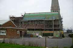 Another illustration of the vast area of roof being renewed. The parish hall is to the left.